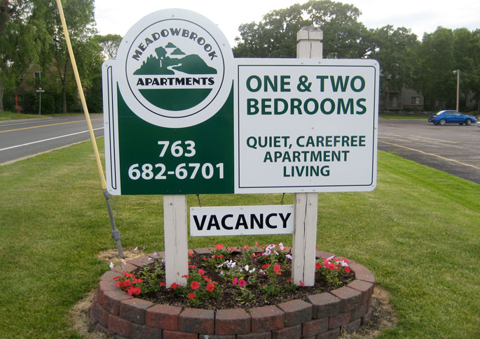 This custom-cut, double sided sign, located in Buffalo, and brings a sense of comfort and success to this apartment complex's entrance.  A great way to establish your rental properties.